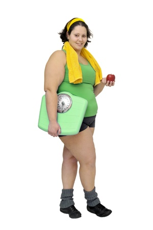 Large girl with weight scale and apple isolated in white Stock Photo - 10037879