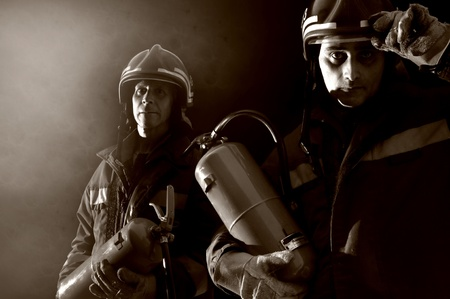 Dramatic image of firemen team in uniform photo