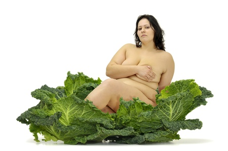 Beautiful large girl with vegetables isolated in white Stock Photo - 10194762