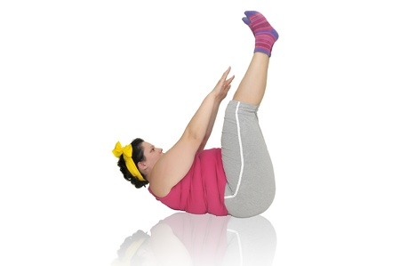 Large girl doing fitness exercises isolated in white Stock Photo - 10194749