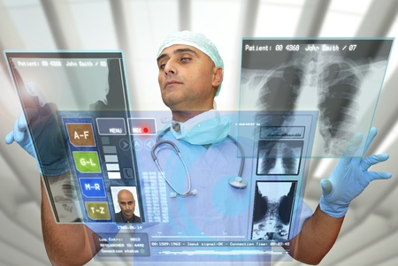 medical technology: Doctor with hightech computer screen viewing patient data