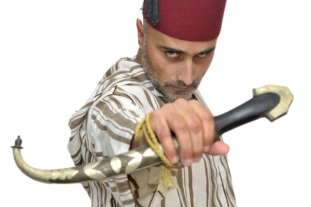 Arabic man with a dagger isolated in white photo