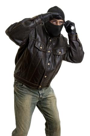 Burglar with flashlight isolated in white photo