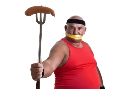 Large fitness man looking at a big sausage isolated in white Stock Photo - 10454063