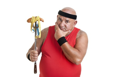 Large fitness man looking at a big sausage isolated in white Stock Photo - 10454067