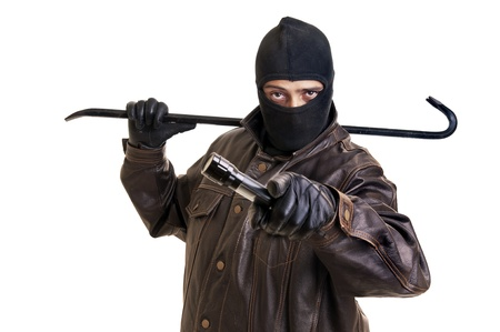 bandits: Burglar with flashlight and crowbar isolated in white