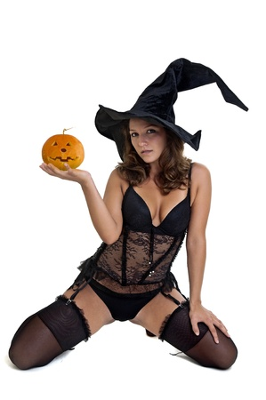 Sexy girl in witch costume isolated in white Stock Photo - 10534165