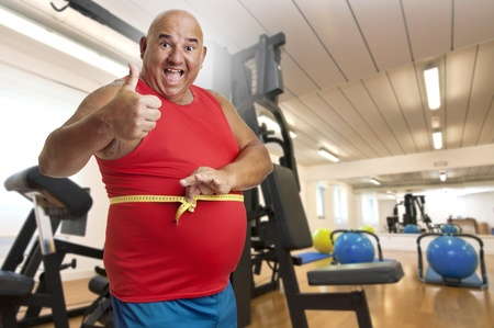 gluttonous: Large fitness man with measuring tape