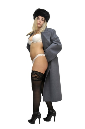 Sexy girl in russian army greatcoat and lingerie isolated in white photo