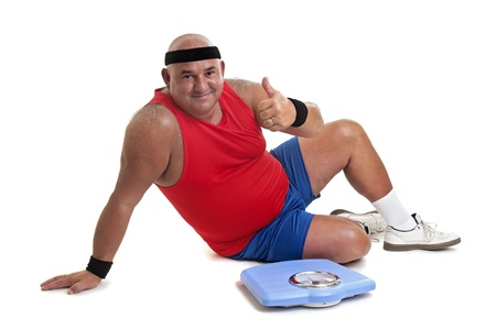 Large fitness man with weight scale isolated in white Stock Photo - 10571772