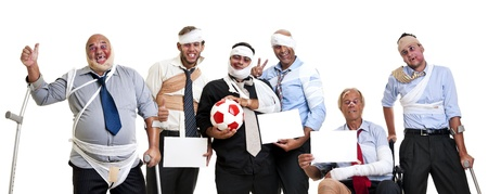 fairplay: Team of injured and happy businessmen after a soccer game Stock Photo