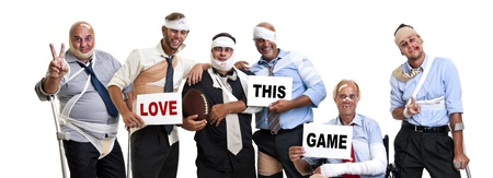 Group of injured businessmen after a rugby game Stock Photo
