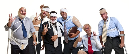 Group of injured businessmen after a rugby game photo