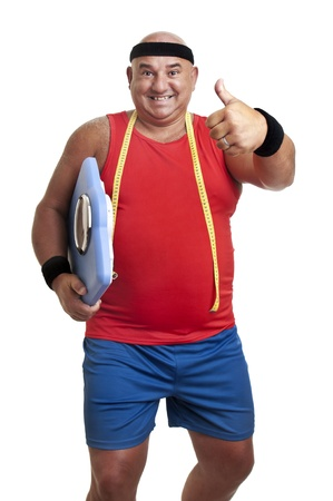 Large fitness man with weight scale isolated in white Stock Photo - 10605610