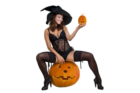Sexy girl in witch costume isolated in white Stock Photo - 10605609