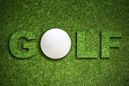 Golf background with a glof ball in the grass photo