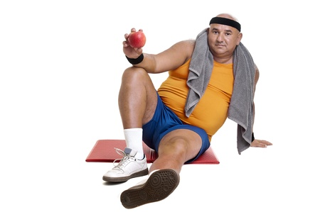 Large fitness man with an apple isolated in white Stock Photo - 10655311