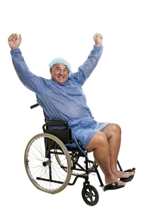 Happy large patient in a wheelchair Stock Photo