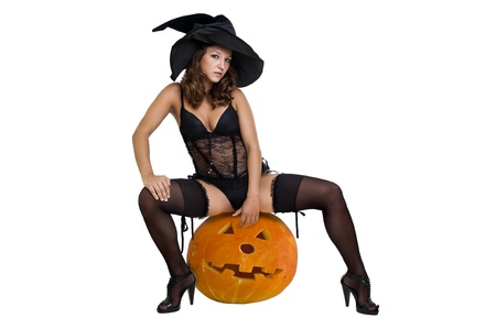 sexy legs stockings: Sexy girl in witch costume isolated in white