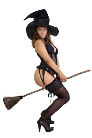 Sexy girl in witch costume isolated in white Stock Photo - 10655306