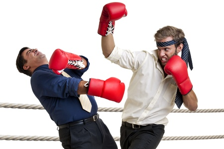 fairplay: Businessmen boxing isolated in white