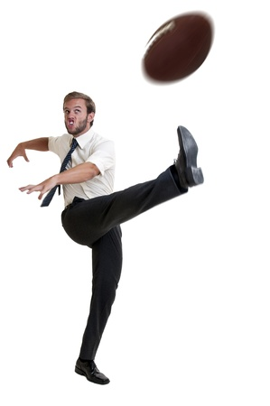 Businessman playing rugby isolated in white photo