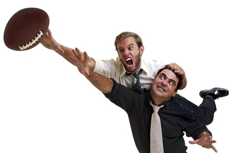 Businessmen playing rugby isolated in white Stock Photo - 10702347