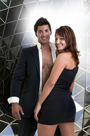 Sexy young couple isolated in a modern background photo