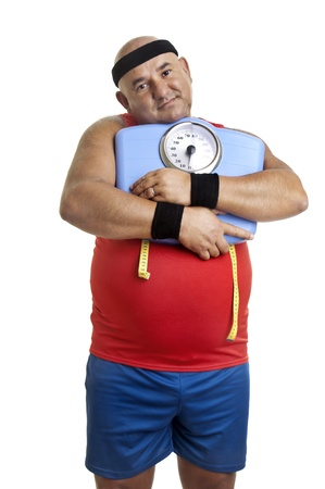 Large fitness man with weight scale isolated in white Stock Photo - 10732304