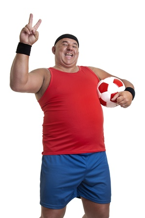 gluttonous: Large man with soccer ball isolated in white
