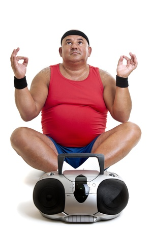 Large fitness man doing yoga exercices isolated in white photo
