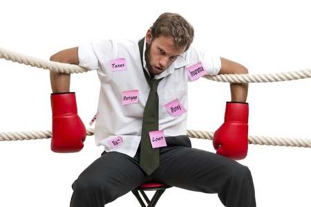 beaten up: Tired  and beaten up businessman with boxing gloves isolated in white Stock Photo