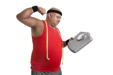 Large fitness man angry with weight scale isolated in white Stock Photo - 10802085