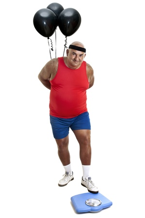 gluttonous: Large fitness man with weight scale and balloons isolated in white