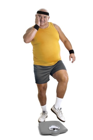 gluttonous: Large fitness man with weight scale isolated in white