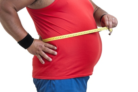 Large fitness man with measuring tape isolated in white photo