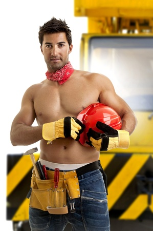 sexy construction worker: Strong build construction worker isolated in white