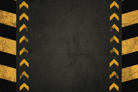 Grunge background, detail of asphalt or wall with yellow stripes photo