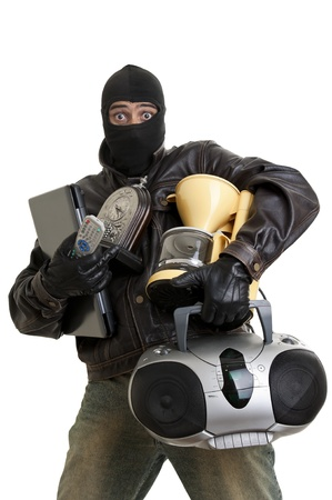 Burglar with goods isolated in white photo