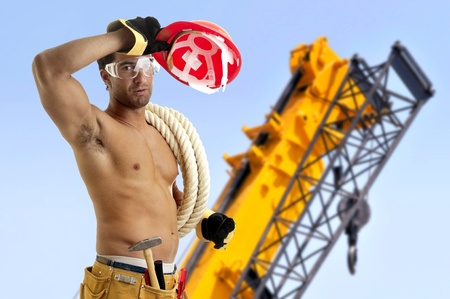 Strong build construction worker in a construction site photo