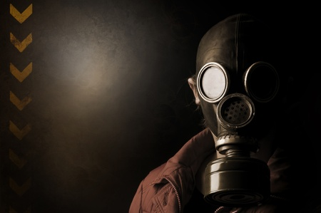 Girl with gas mask in a grunge background photo
