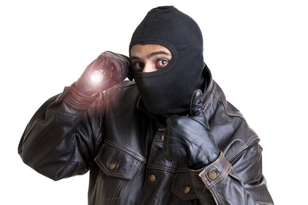 Burglar with flashlight isolated in white photo