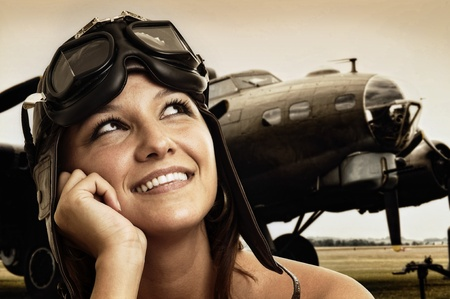 airman: Beautiful young pilot hat and goggles Stock Photo
