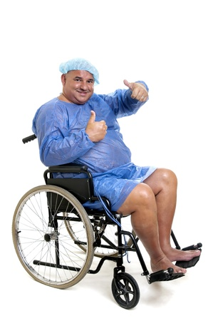 Happy large patient in a wheelchair photo