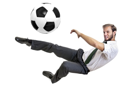 Businessman playing soccer isolated in white photo