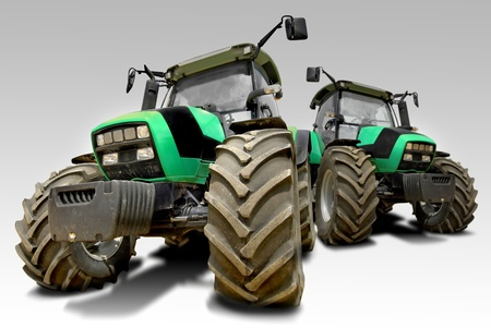 Green tractors isolated in white photo