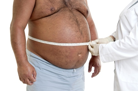 Large male patient belly with doctor Stock Photo