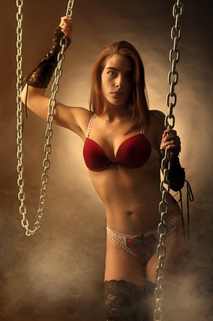 Sexy girl in lingerie posing with chains photo