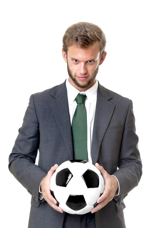 fairplay: Businessman with soccer ball isolated in white Stock Photo