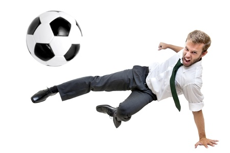 fairplay: Businessman playing soccer isolated in white